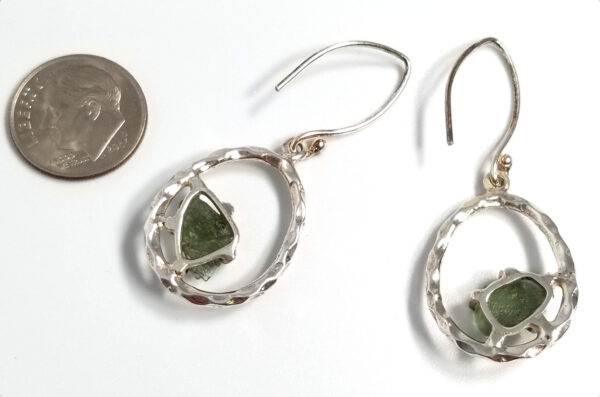 back of moldavite earrings with dime for scale
