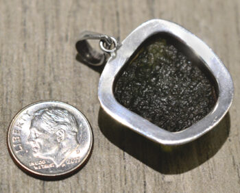back of rough green moldavite and sterling silver pendant with dime