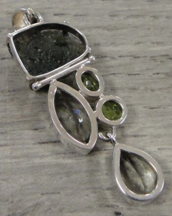 back of moldavite, peridot, and green amethyst pendantback of moldavite, peridot, and green amethyst pendant