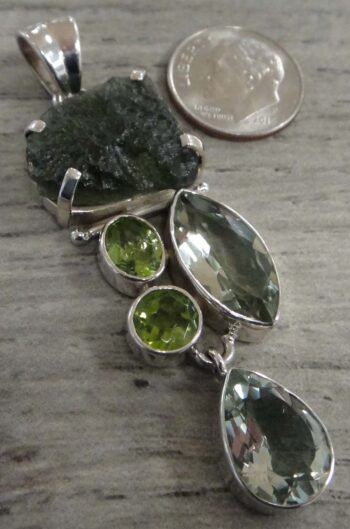moldavite, peridot and green amethyst pendant with dime for size