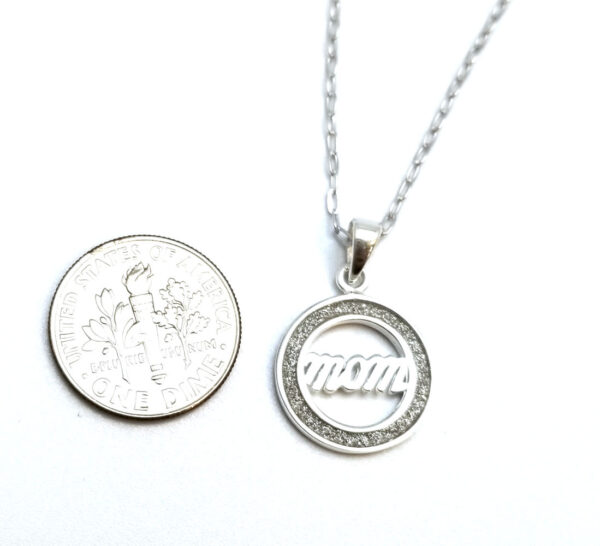 mom necklace with dime to show scale