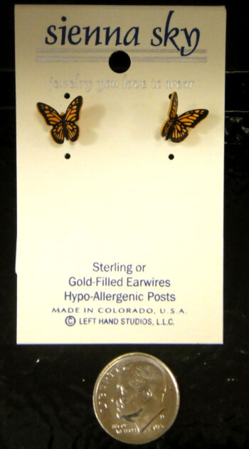 Monarch stud earrings with dime for scale