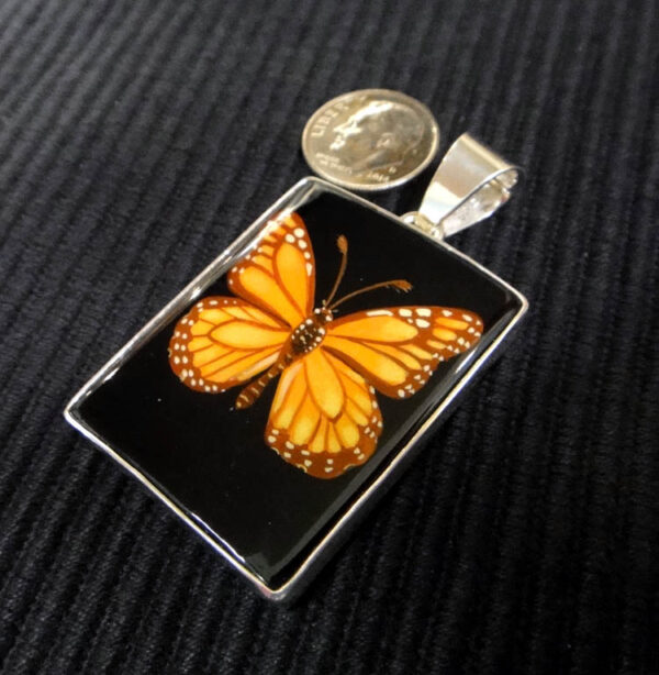 Hand painted monarch on black agate pendant