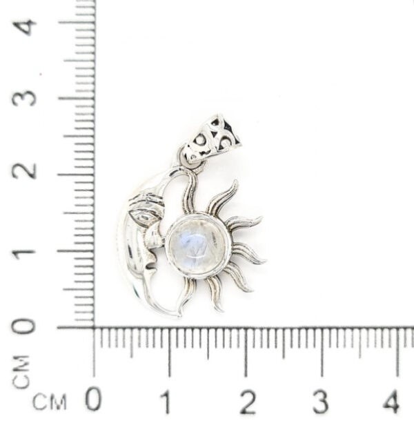 moon and sun pendant with ruler