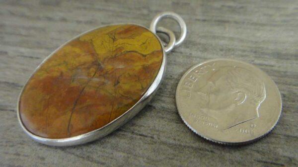 morgan hill poppy jasper pendant with dime for size