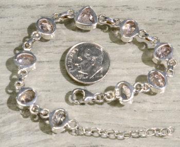 back of morganite bracelet with dime