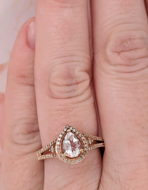 Morganite, diamond, and rose gold ring on hand