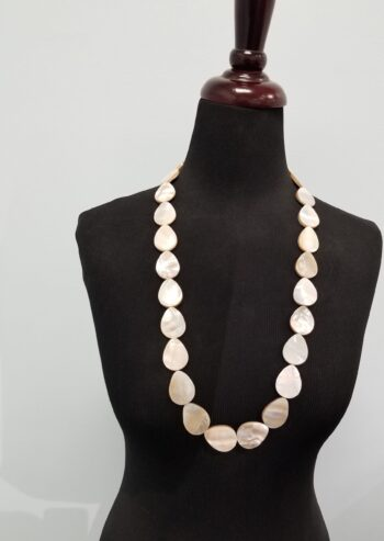 Long mother of pearl shell necklace on mannequin