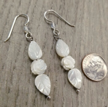 long mother of pearl rose earrings with dime for scale