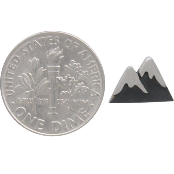 mountain earring with dime to help gauge size
