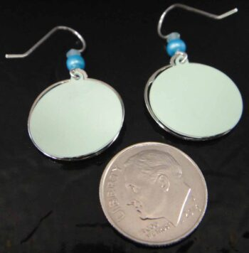 Back of blue mountain dangle earrings with dime for scale