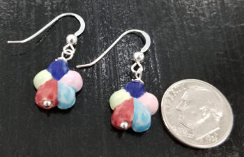 back of multi-color flower earrings with dime for scale