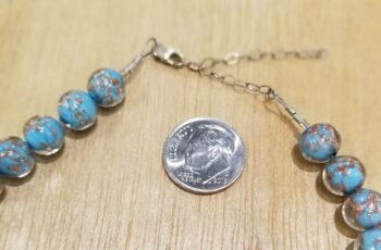 clasp of Murano glass necklace with dime for scale