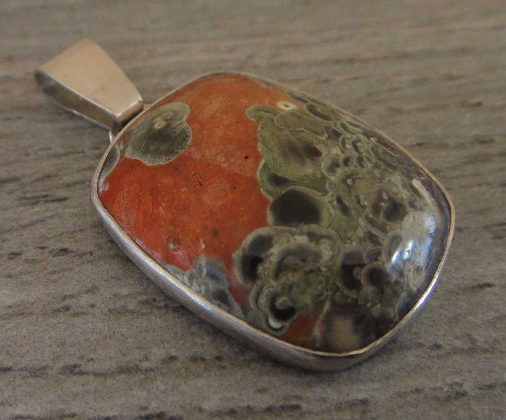 Handmade orange and green mushroom jasper and sterling silver pendant