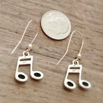 back of music note earrings with dime for scale