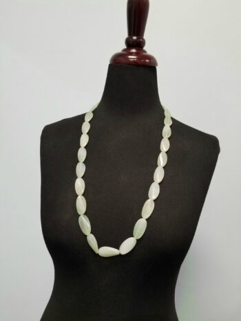 new jade long necklace on mannequin