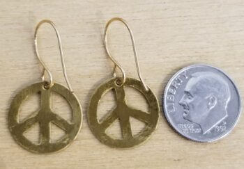 backside of olive green peace sign earrings with dime for scale