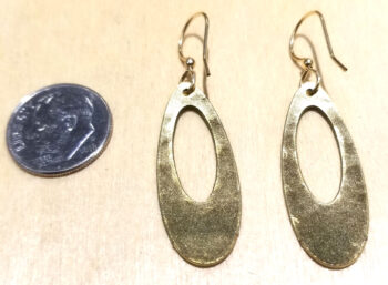 back of olive green earrings with dime for scale