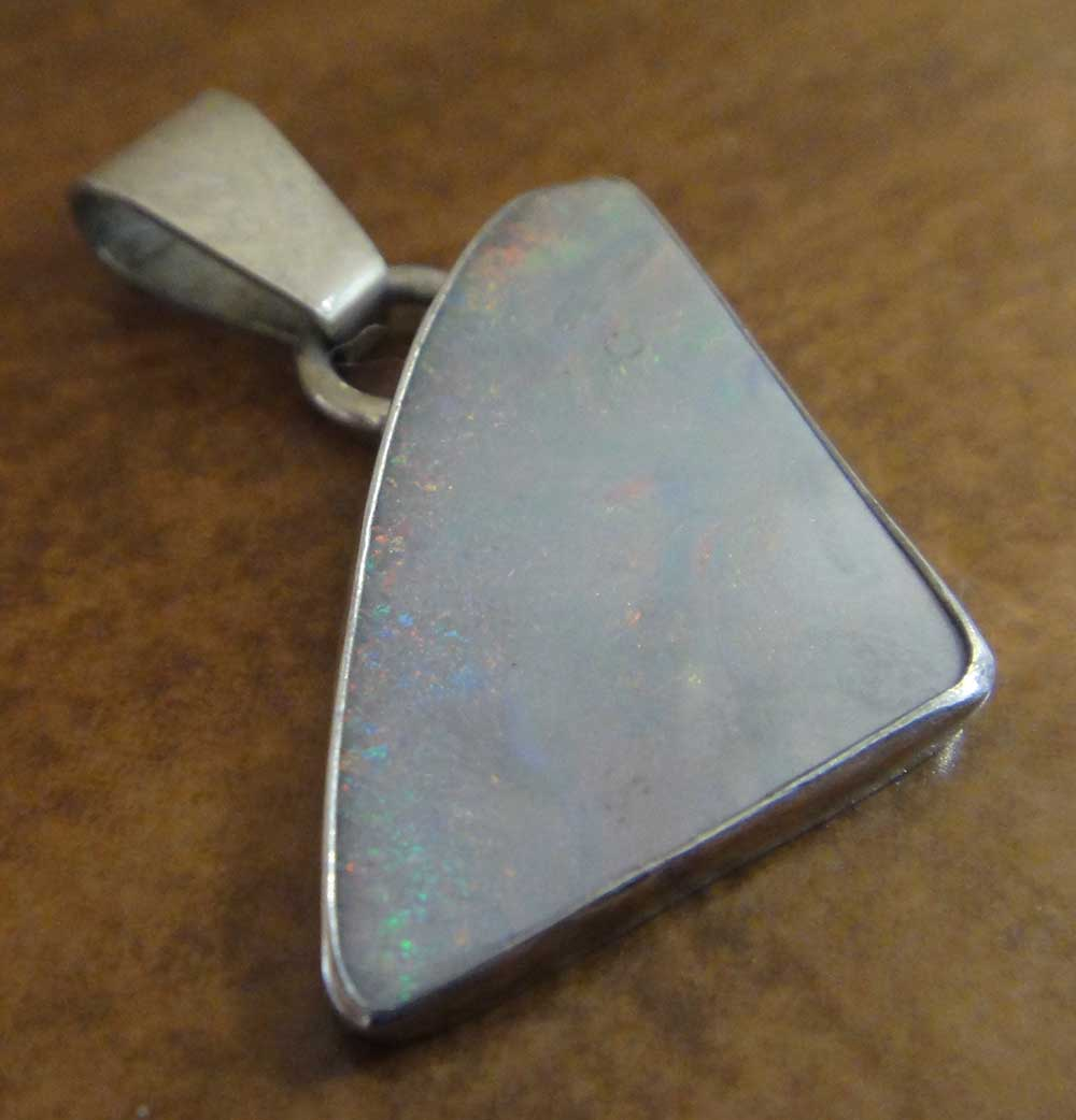 White lab grown opal and sterling silver pendant handmade by Dale Repp in Lone Tree, Iowa