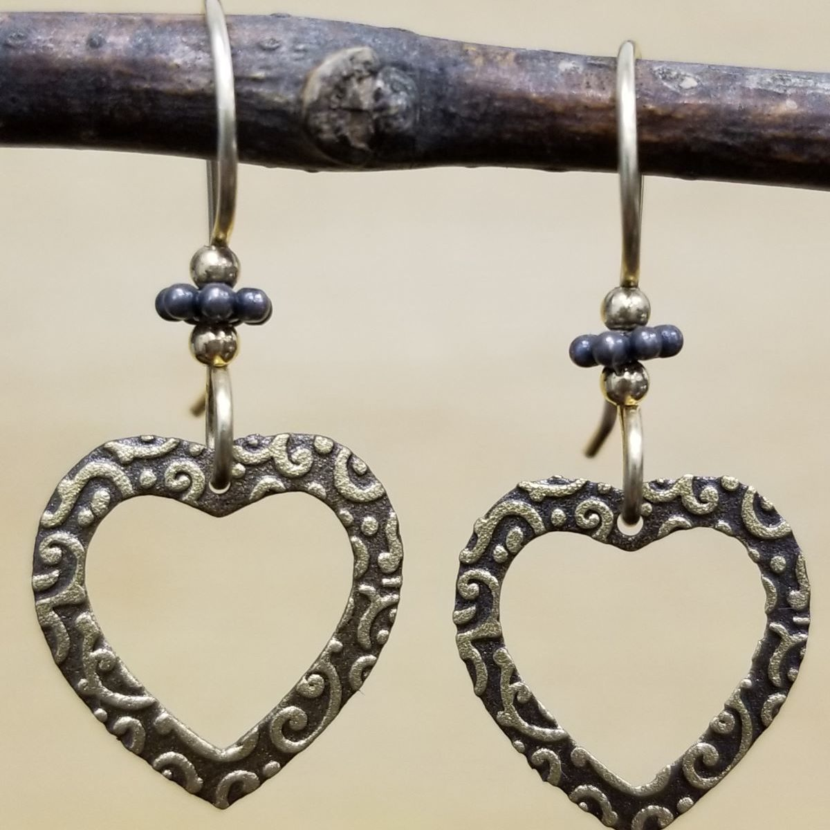 open heart earrings by Joseph Brinton