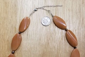close-up of clasp and extender for aventurine necklace