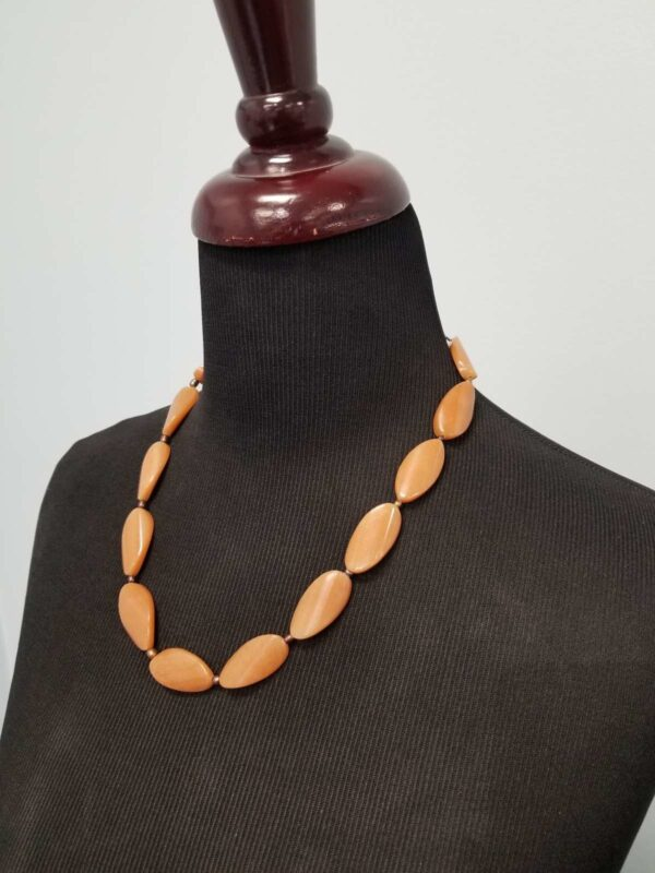 close-up of aventurine necklace on mannequin