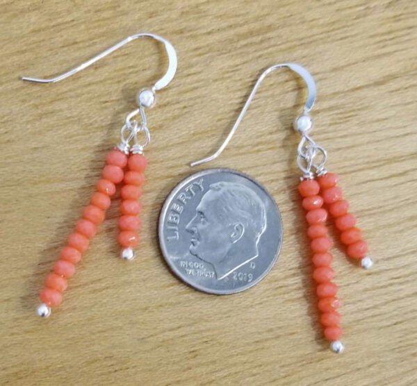 bright orange beaded earrings with dime for scale