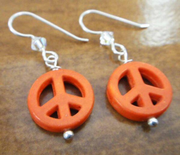 handmade orange peace signs, swarovski crystal beads, and sterling silver earrings
