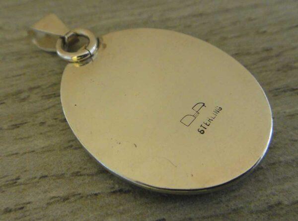 back of orbicular agate pendant