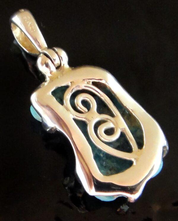 Back of turquoise pendant