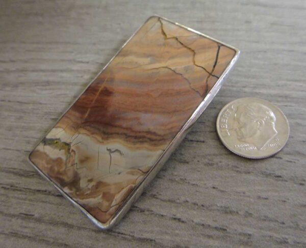 rectangular orsk jasper pendant with dime for size