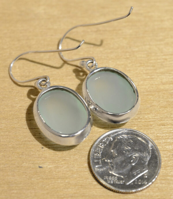 back of handmade oval pale blue chalcedony drop earrings with dime