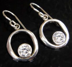 These white cubic zirconia and sterling silver earrings are handmade by Sonoma Art Works.