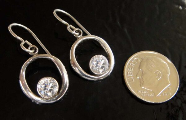 These white cubic zirconia and sterling silver oval earrings are handmade by Sonoma Art Works (pictured with dime for scale)
