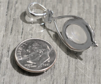 back of oval rainbow moonstone and sterling silver pendant with dime