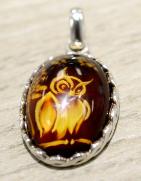 carved amber and sterling silver pendant