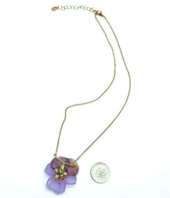 back of pansy necklace with dime for scale