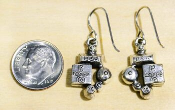 back of Park Avenue drop earrings by Patricia Locke with dime for size