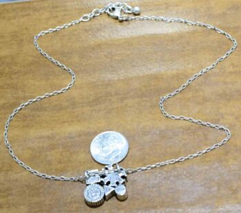 back of Spirit silver tone necklace by Patricia Locke with dime for size