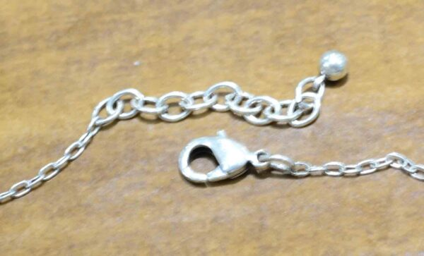 clasp of Spirit silver tone necklace by Patricia Locke