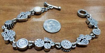 back of Petite style bracelet by Patricia Locke with dime for size
