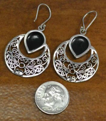back of paua shell and sterling silver filigree earrings with dime for size