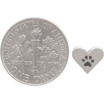paw print earring next to dime for scale