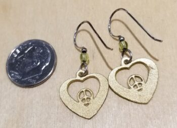 back of peace and love earrings with dime for scale