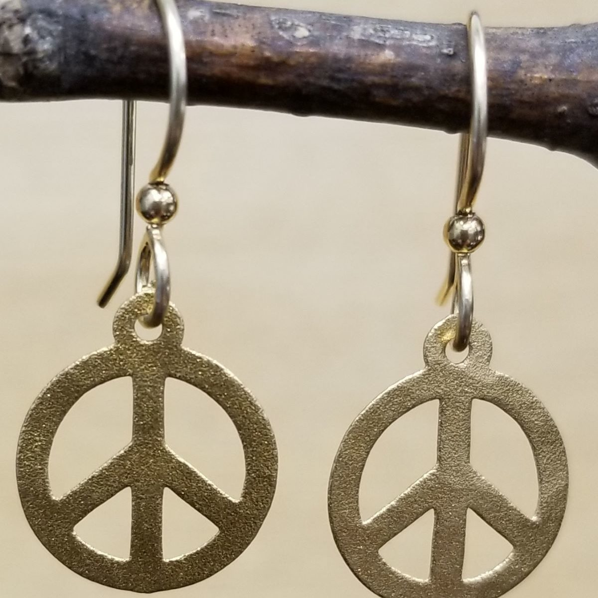petite peace sign earrings by Joseph Brinton