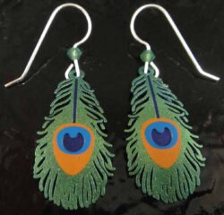 These peacock feather dangle earrings are handmade by Sienna Sky.