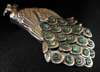 close-up of handmade malachite, garnet, sterling silver peacock pendant/pin