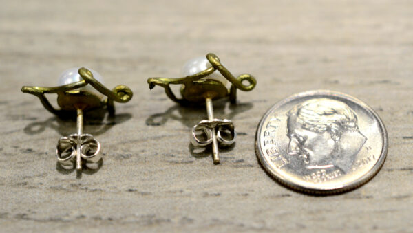 back of pearl and bronze Pea Pod earrings with dime for size