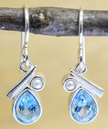 These blue topaz and freshwater pearl dangle earrings are handcrafted by Sonoma Art Works.