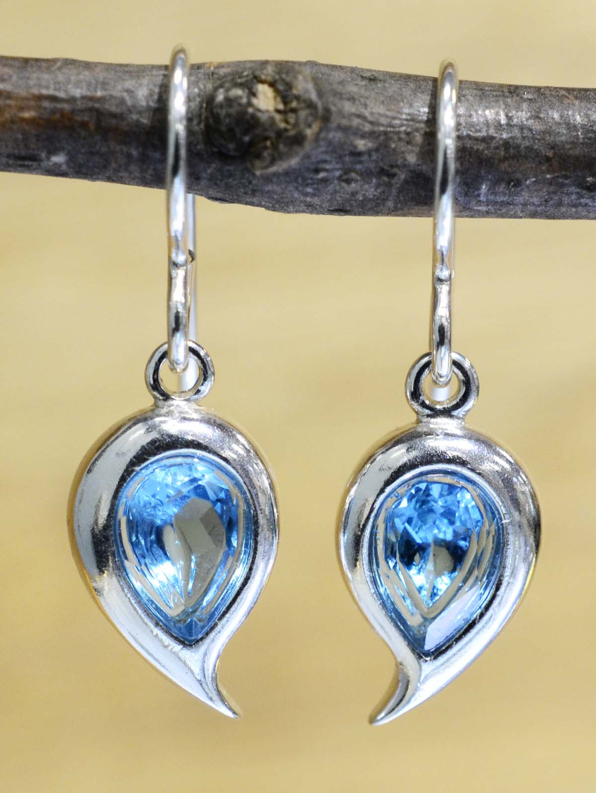 These blue topaz dangle earrings are handmade by Sonoma Art Works.